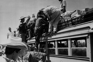 Illegal Mexican immigrant farm workers boarding buses during Operation Wetback