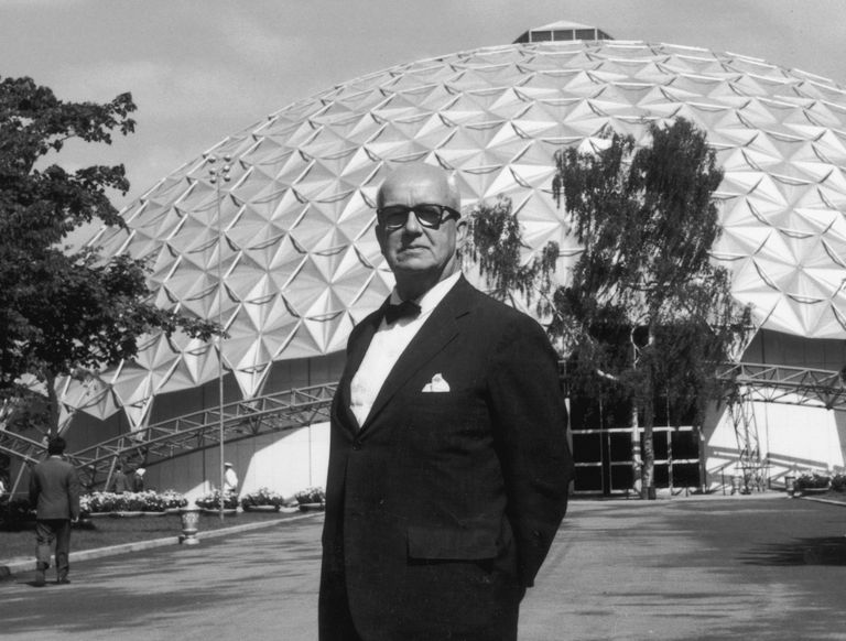 Richard Buckminster Fuller in front of a geodesic dome, the design of which he invented, c. 1960