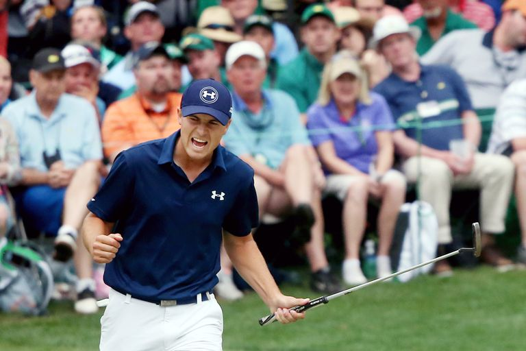 Jordan Spieth celebrates a par-saving putt on the 16th hole during the final round of the 2015 Masters