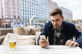 Man annoyed at his phone