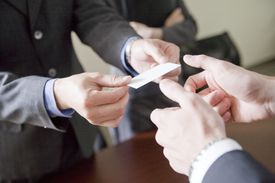 business people exchanging a business card