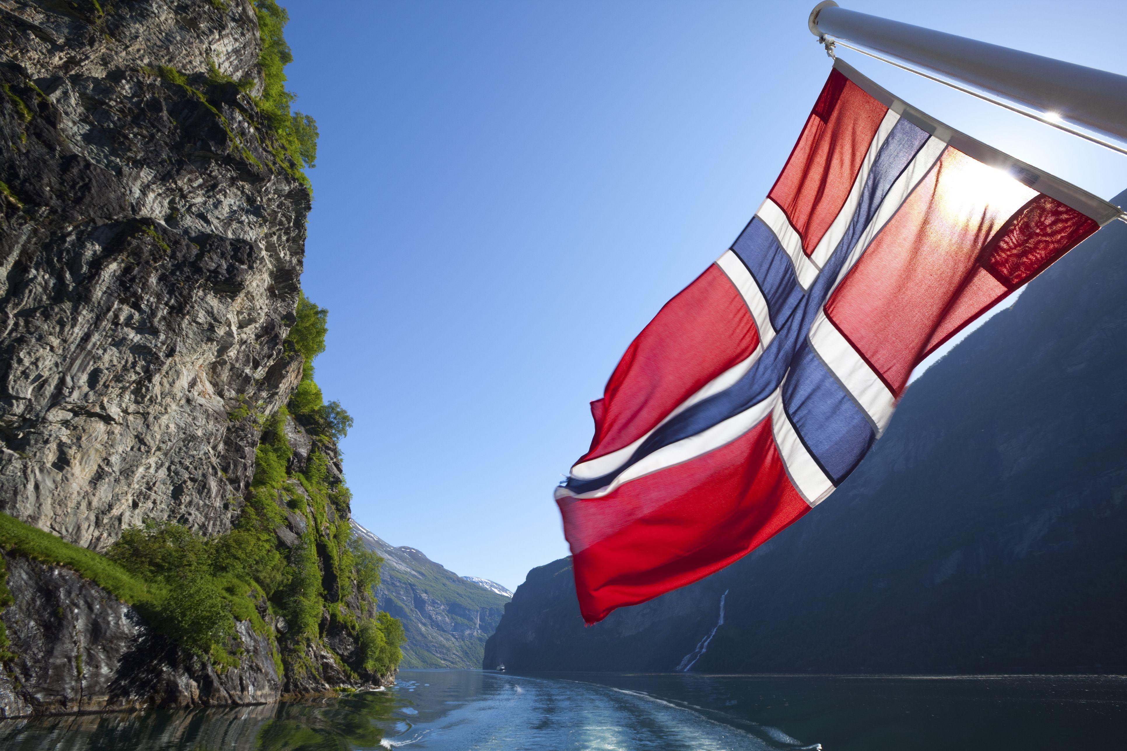 Norwegian flag on ferry in Geiranger Fjord, Norway