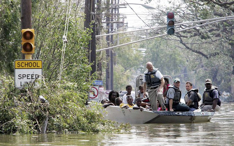 Refugees in boat during cleanup during hurricane Katrina's Aftermath.