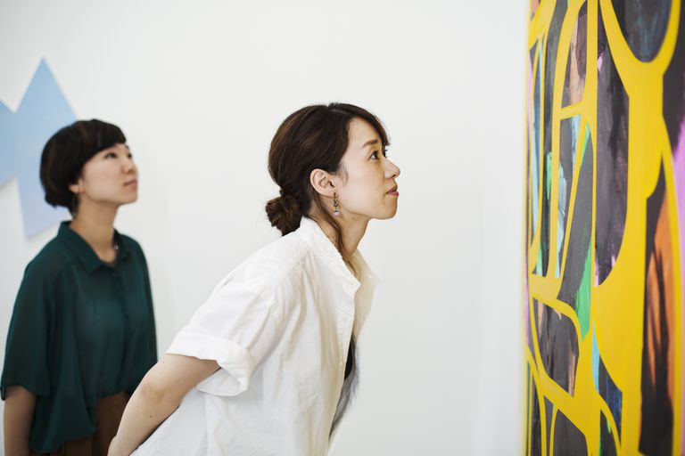 two women looking at art
