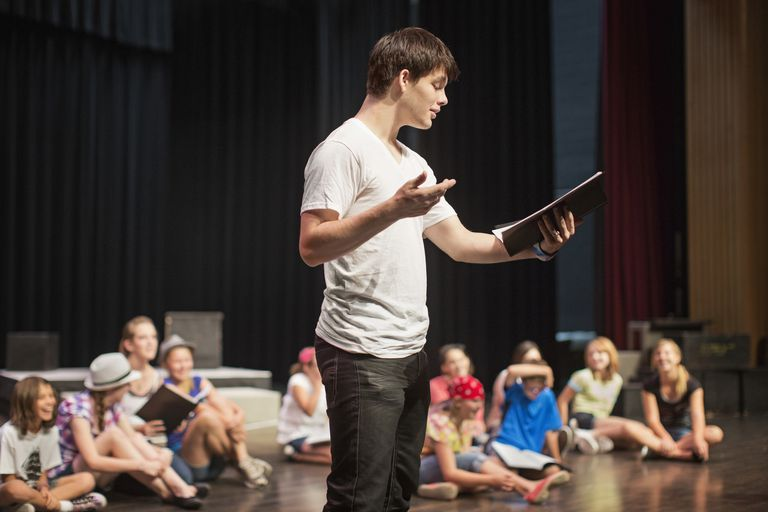 Actor practicing lines during rehearsal.