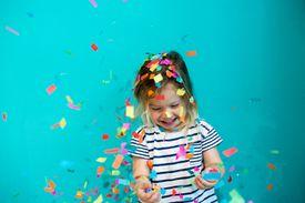 Colorful confetti falling on Caucasian girl