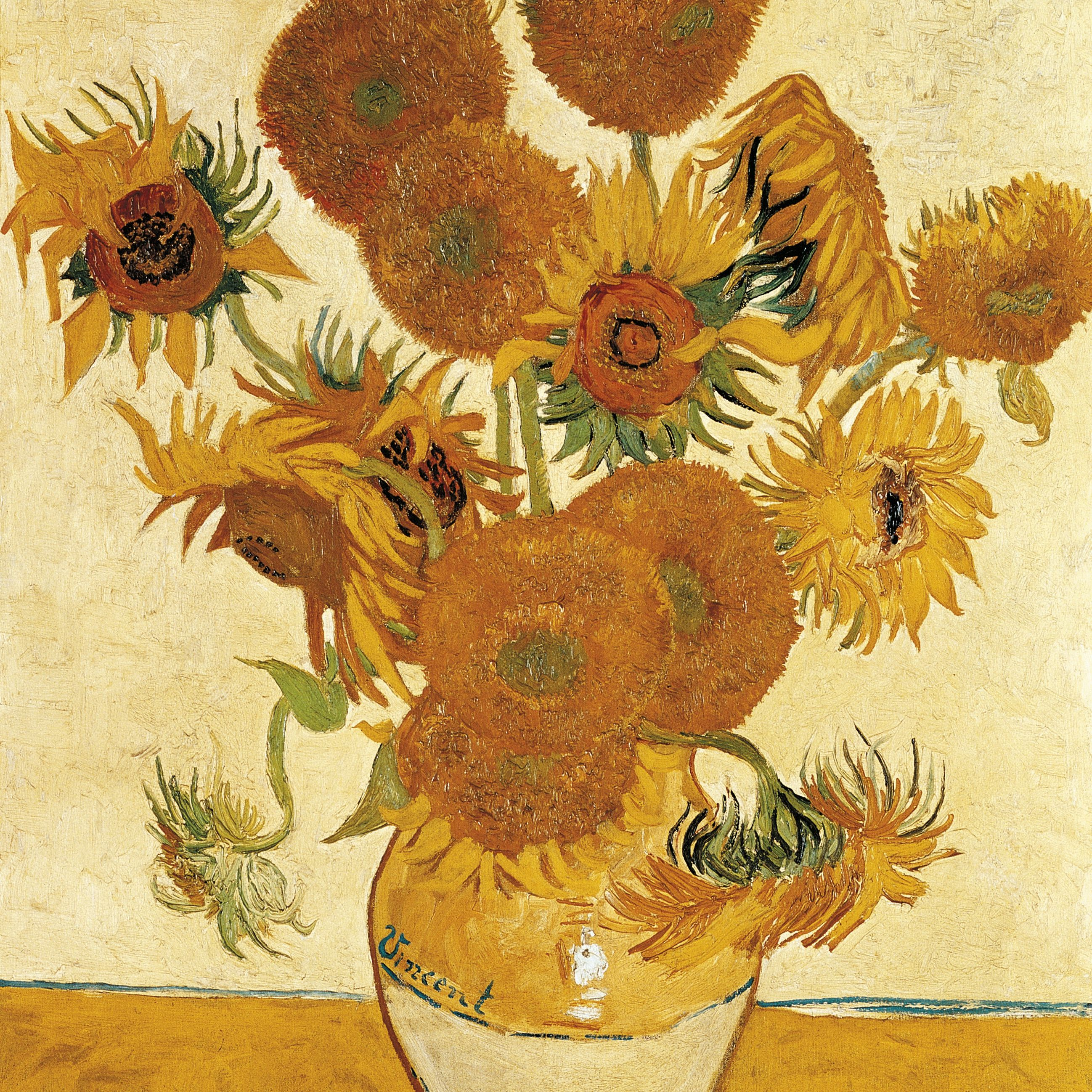 Yellow sunflowers in a yellow vase on a yellow table.