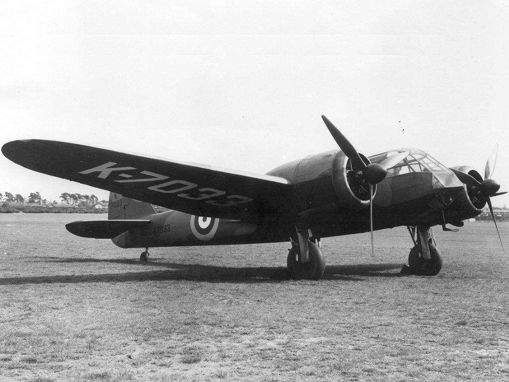 A twin-engine Bristol Blenheim bomber at an airfield.