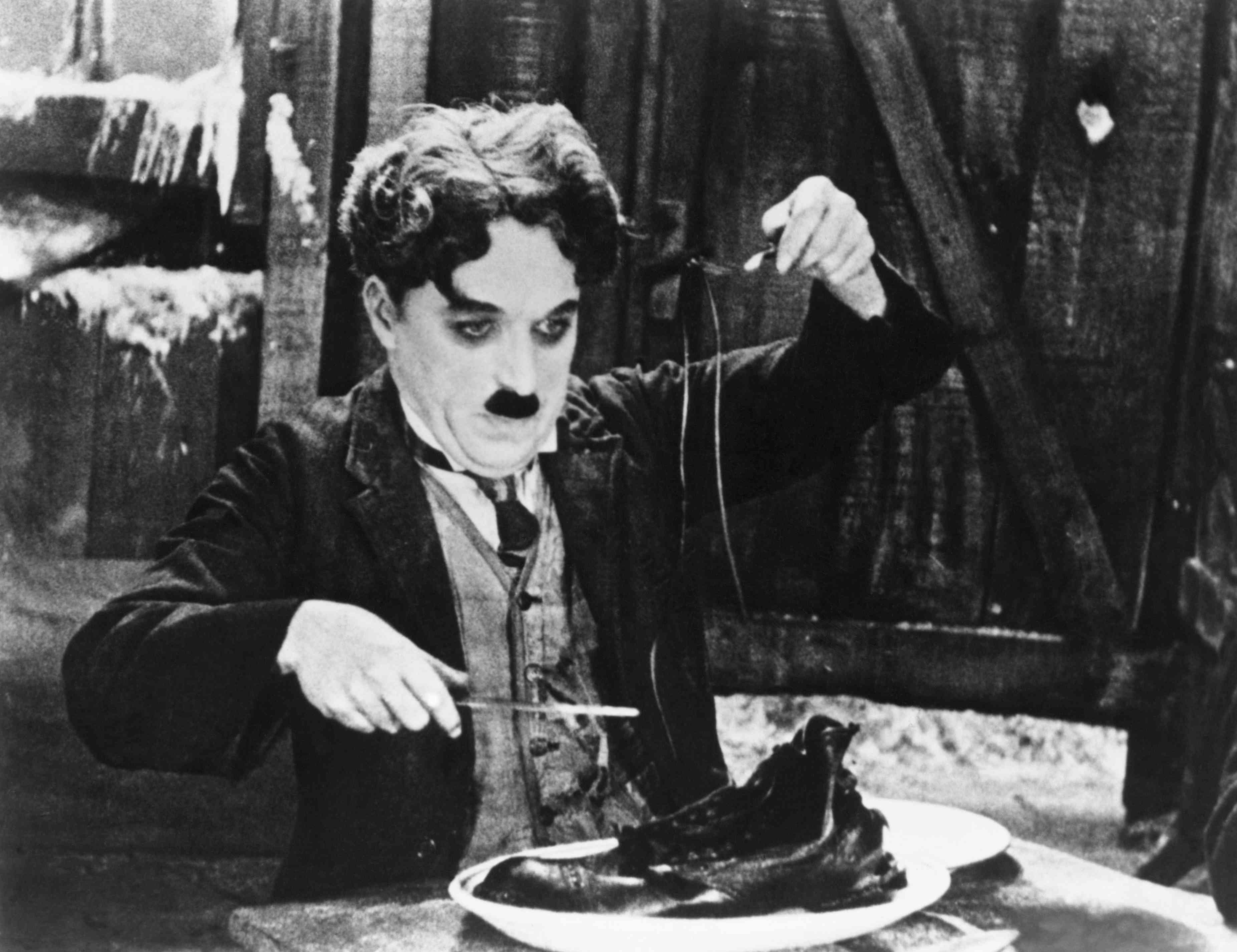 Charlie Chaplin in the Shoe-Eating Scene from The Gold Rush.