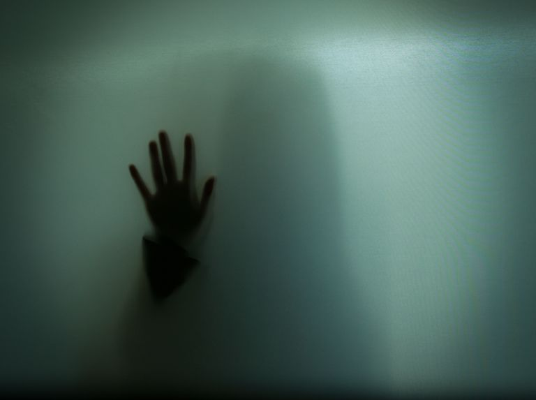 Hand Shadow Of Woman On Glass