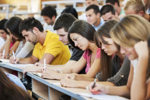 Large group of students writing.