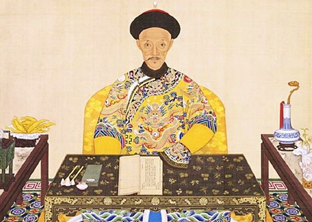 A Qing emperor of China writing