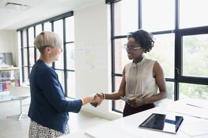 Women shaking hands in an office