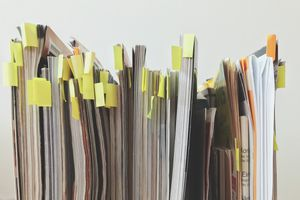 Row of magazines with sticky notes marking various pages