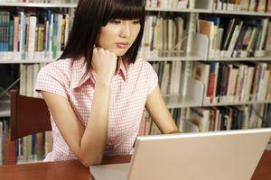 Young woman studying at computer