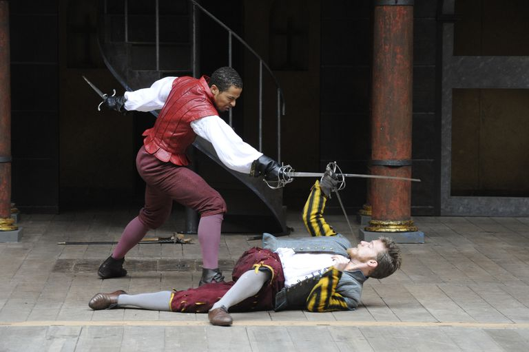 Philip Cambus as Mercutio and Ukweli Roach as Tybalt sword fighting/doing stage combat in a production of William Shakespeare's play 'Romeo and Juliet' at Shakespear's Globe Theatre in London