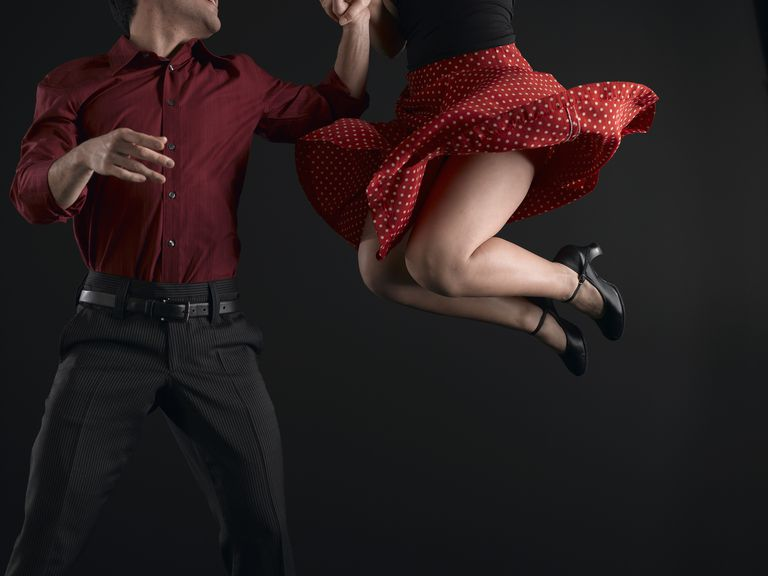 Couple swing dancing, low section