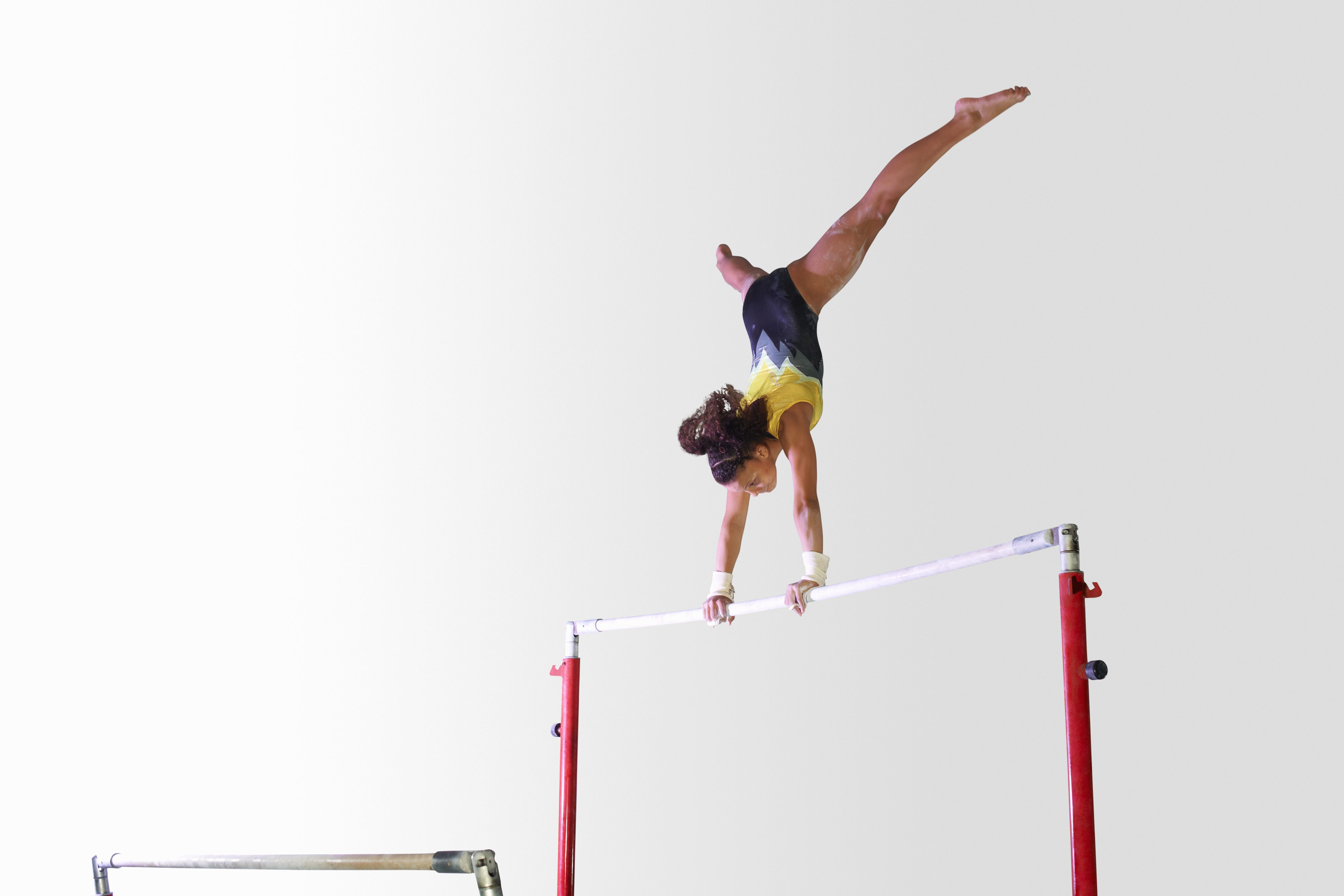 all about the uneven bars in gymnastics
