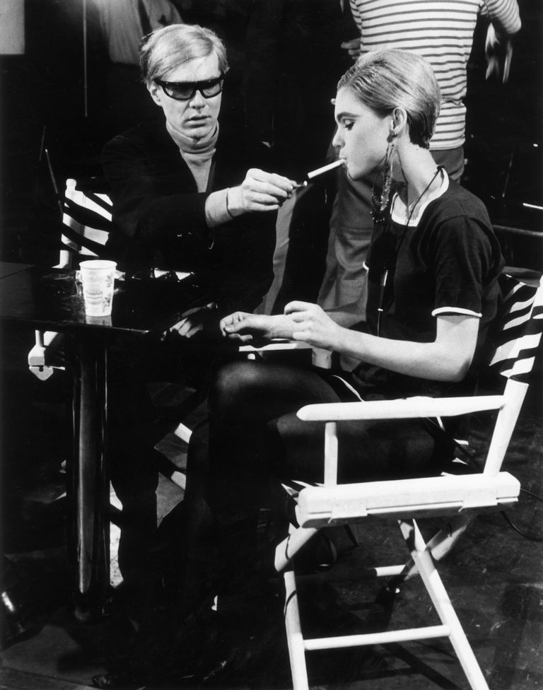 : American Pop artist Andy Warhol (1928 - 1987) sits next to actor Edie Sedgwick