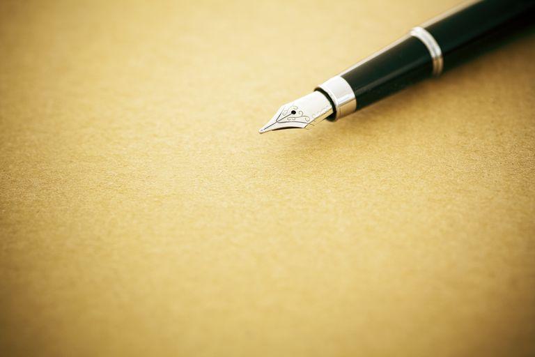 Elegant fountain pen on old empty paper