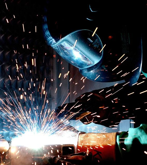 a MIG welder at work.