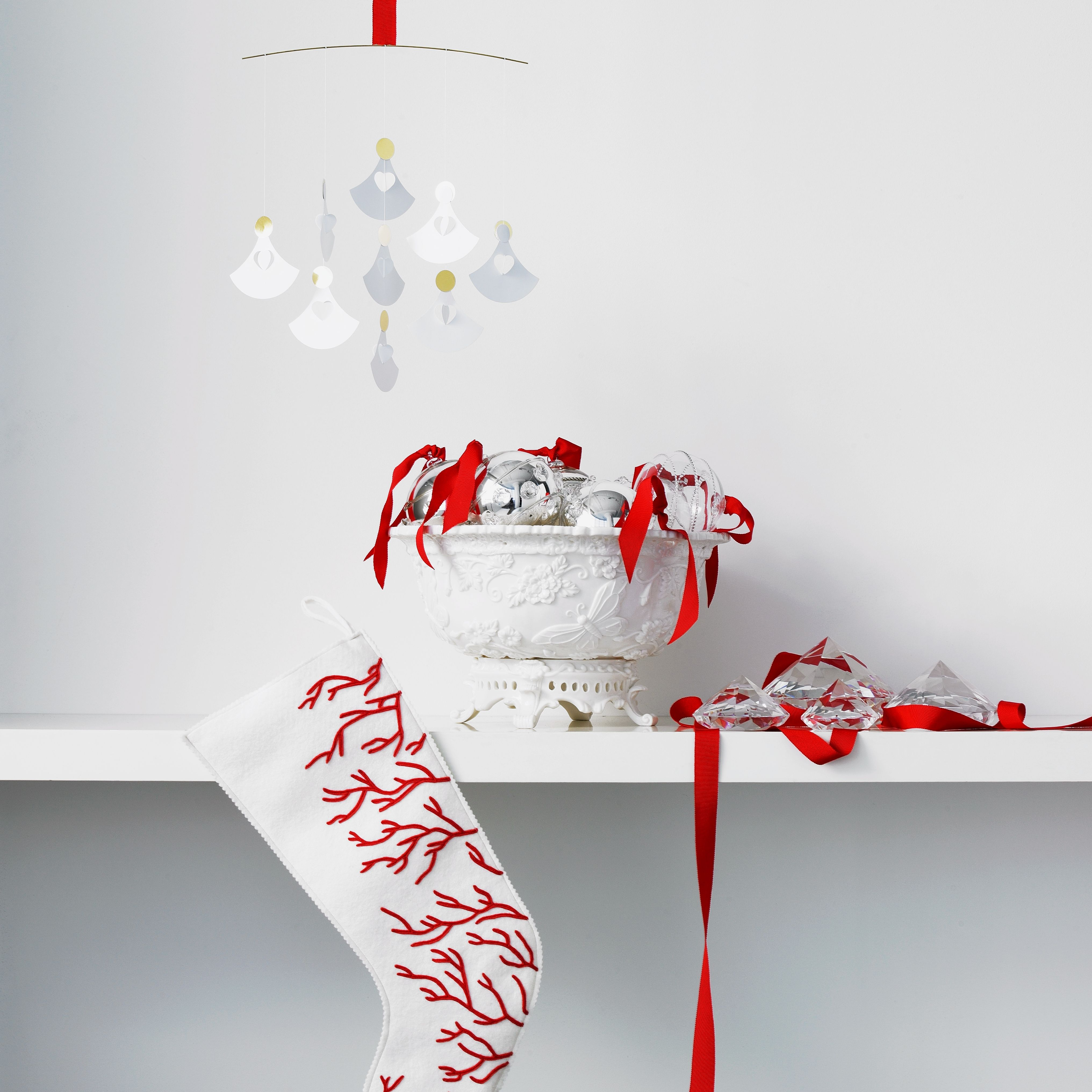 Soak a holiday stocking in crystal solution to make a glittery crystal decoration or ornament.
