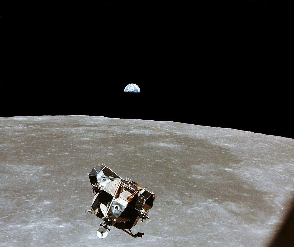 Apollo 11 lunar module rising above moon