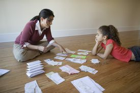 Mother going through bills with daughter