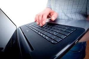 Male office worker with laptop