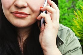 woman taking a call on cell phone