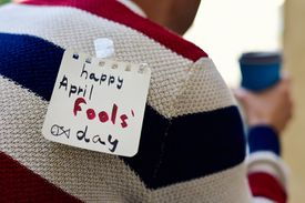 young man and text happy april fools day