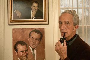 Norman Rockwell in front of his work