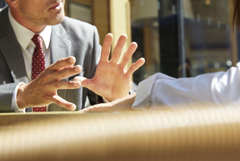 Business mans hands making a gesture