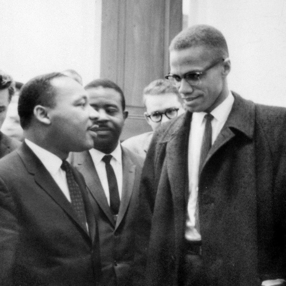 Martlin Luther King Jr. and Malcolm X talking