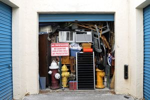 Full Overflowing Storage Unit Bursting with Heap of Junk