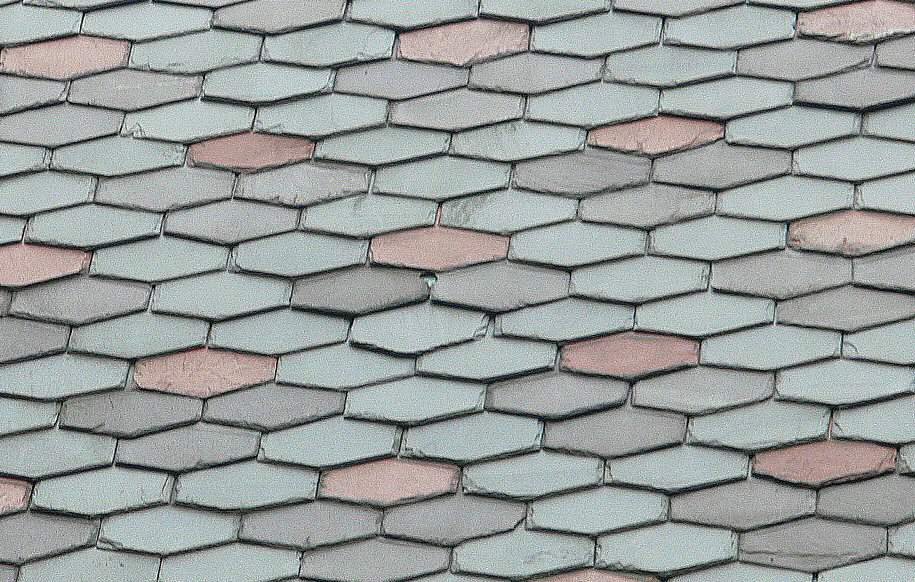 Colored slates form patterns on the slate roof of the Mark Twain House