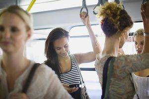 A collection of women riding a bus together.
