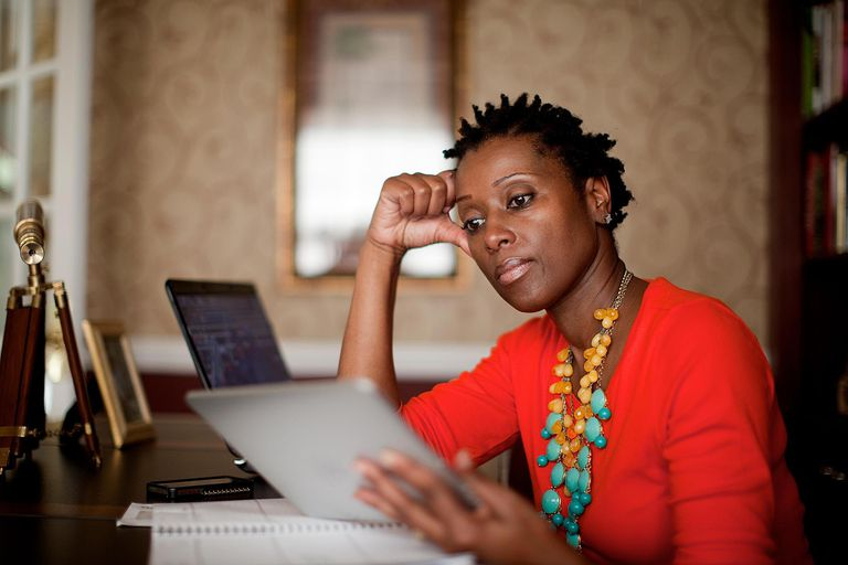 African-American woman in home office with tablet