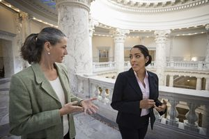 Two women talking in government building