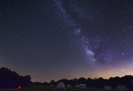 Two Perseid meteors streak across the Milky Way during the 2012 meteor shower in Oklahoma.