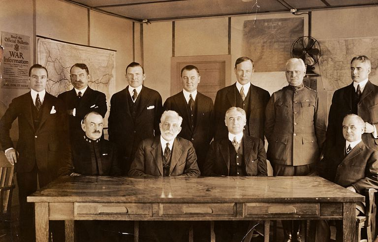 War Industries Board. Seated from left to right are: Seated, Admiral F.F. Fletcher; Robt. S. Brookings, chairman price-fixing committee; Bernard N. Baruch.