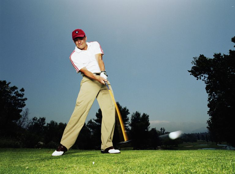 Golfer just after impact with driver showing a positive angle of attack.