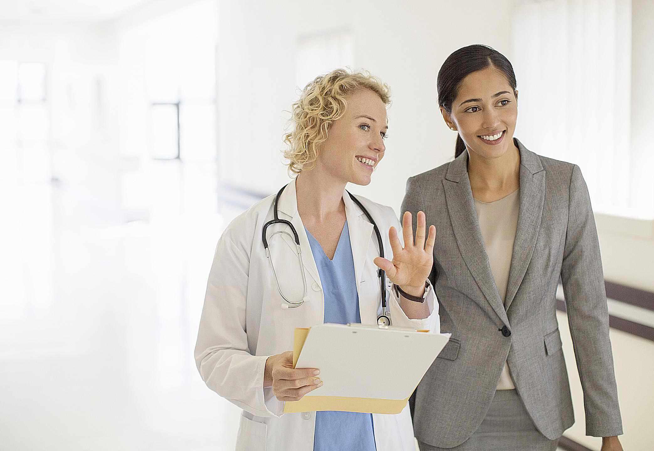 Conversation with Nurse - Paul Bradbury - Caiaimage - GettyImages-184312672