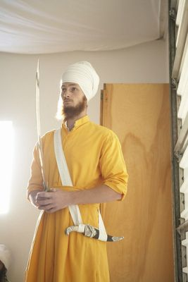 A Sikh Holds a Sword to Guards the Door of the Amrit Ceremony
