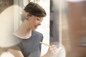 Woman jotting in notebook