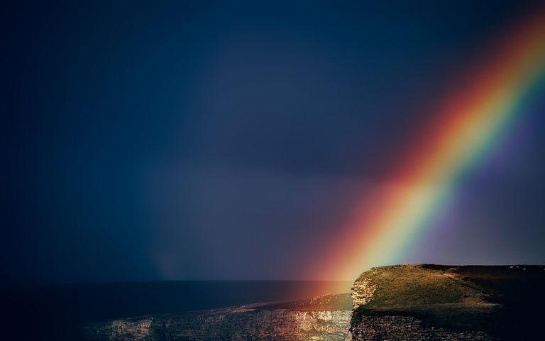 Rainbow against a dark sky.