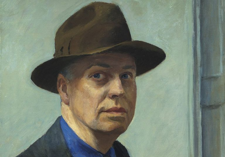 Solemn-faced Edward Hopper wearing a brown hat.