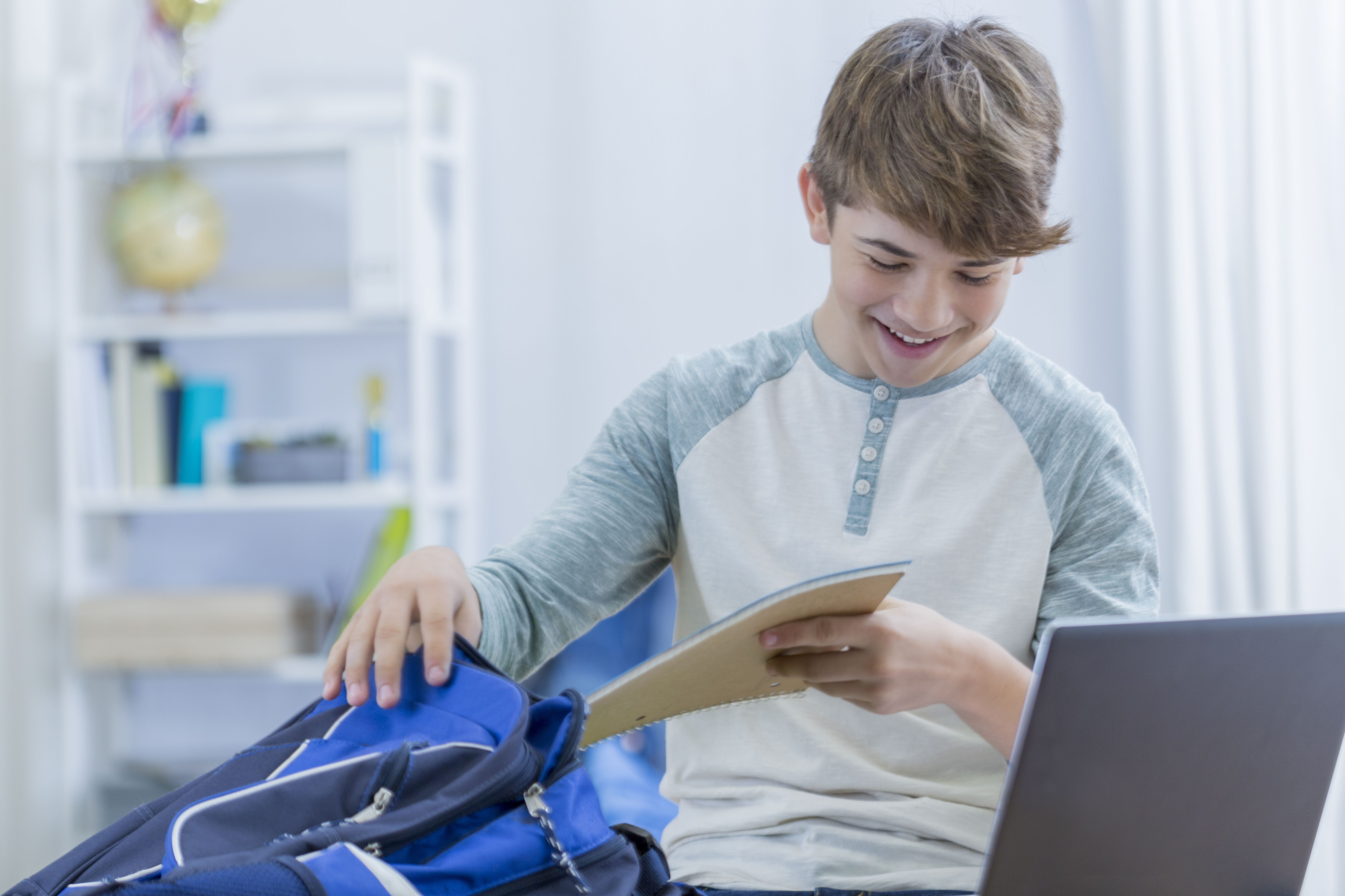 Boy packing a backpack
