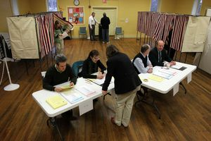 Election officials helping voters