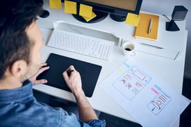 Web designer developing responsive website layout